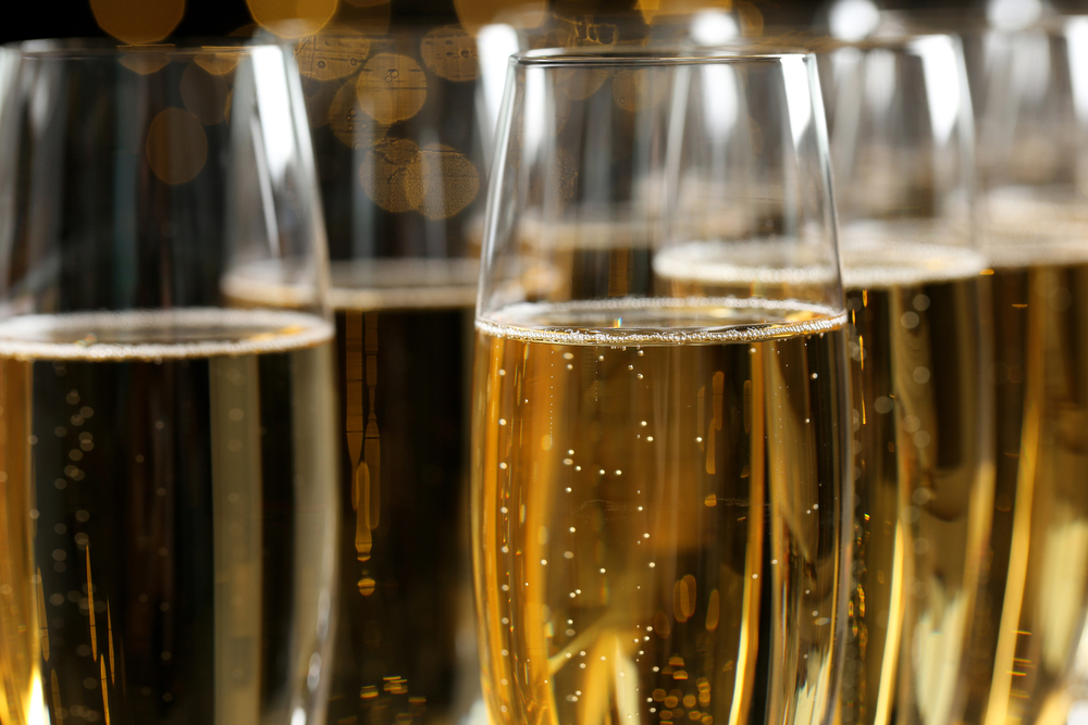 Many glasses of champagne as background, closeup