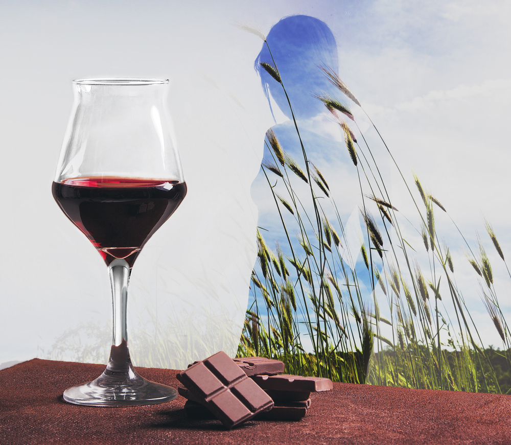 Wine with chocolate and double exposed girl in wheat field